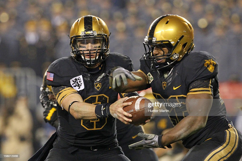 Trent Steelman #8 of the Army Black Knights hands off during a game against the Navy Midshipmen on December 8, 2012 at Lincoln Financial Field in Philadelphia, Pennsylvania. The Navy won 17-13.