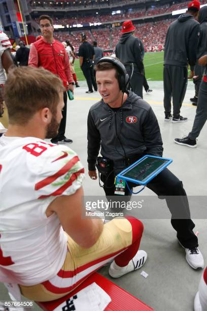 Trent Taylor and Wide Receivers/Passing Game Specialist Mike LaFleur of the San Francisco 49ers talk on the sideline during the game against the...