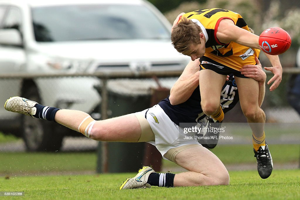 Trent Thompson of the Geelong Falcons (R) tackles Sam Fowler of the Dandenong Stingrays during the round eight TAC Cup match between Dandenong Stingrays and Geelong Falcons at Shepley Oval on May 29, 2016 in Melbourne, Australia.