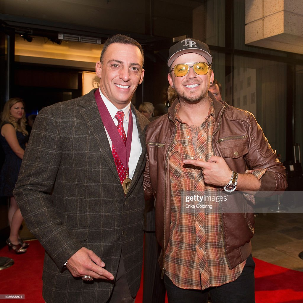 Trent Tomlinson and Love and Theft's Stephen Liles attend the 63rd Annual BMI Country awards on November 3 2015 in Nashville Tennessee