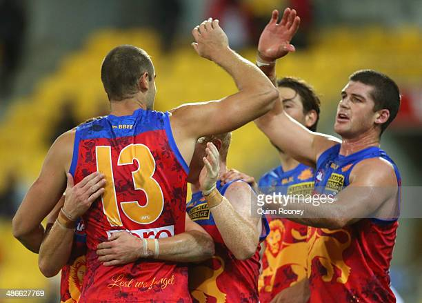 Trent West Josh Green Jonathan Brown and Marco Paparone of the Lions celebrate winning the round six AFL match between the St Kilda Saints and the...