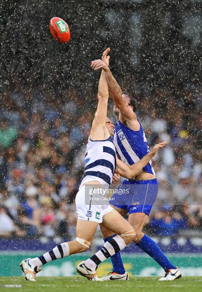 Trent West of the Cats and Todd Goldstein of the Kangaroos contest the ruck in pouring rain during the round two AFL match between the Geelong Cats and the North Melbourne Kangaroos at Etihad Stadium on April 7, 2013 in Melbourne, Australia.