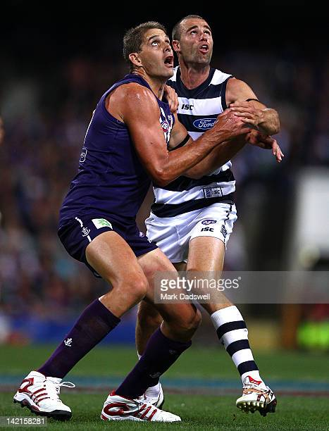 Trent West of the Cats contests a boundary throw in with Aaron Sandilands of the Dockers during the round one AFL match between the Fremantle Dockers...