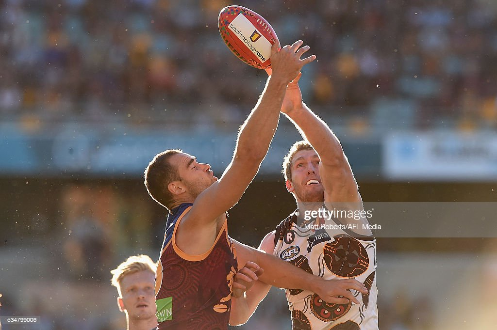 Trent West of the Lions competes for the ball against Ben McEvoy of the Hawks during the round 10 AFL match between the Brisbane Lions and the Hawthorn Hawks at The Gabba on May 28, 2016 in Brisbane, Australia.
