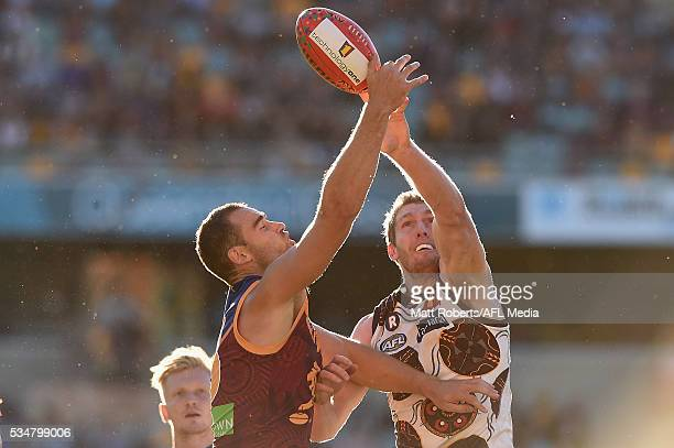 Trent West of the Lions competes for the ball against Ben McEvoy of the Hawks during the round 10 AFL match between the Brisbane Lions and the...
