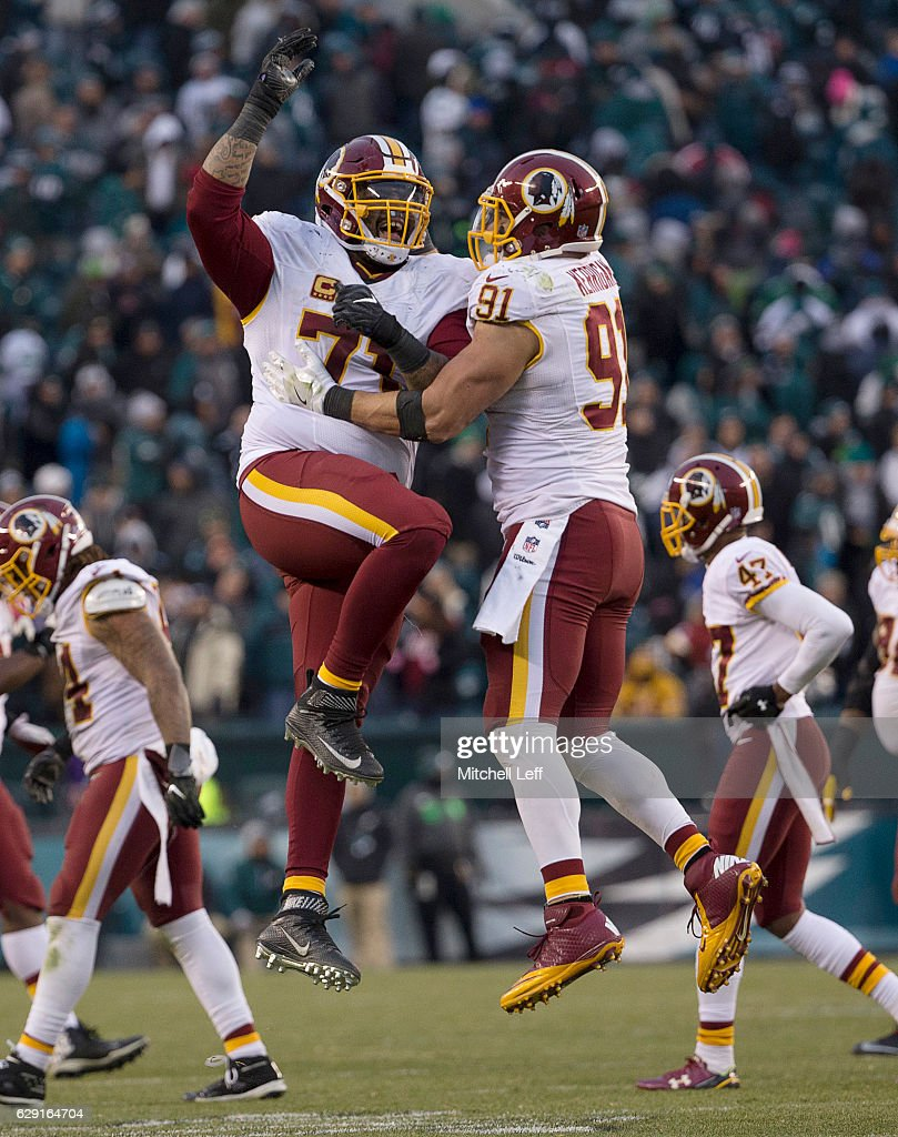 Trent Williams #71 of the Washington Redskins celebrates with Ryan Kerrigan #91 in the final moments of the game against the Philadelphia Eagles at Lincoln Financial Field on December 11, 2016 in Philadelphia, Pennsylvania. The Redskins defeated the Eagles 27-22.