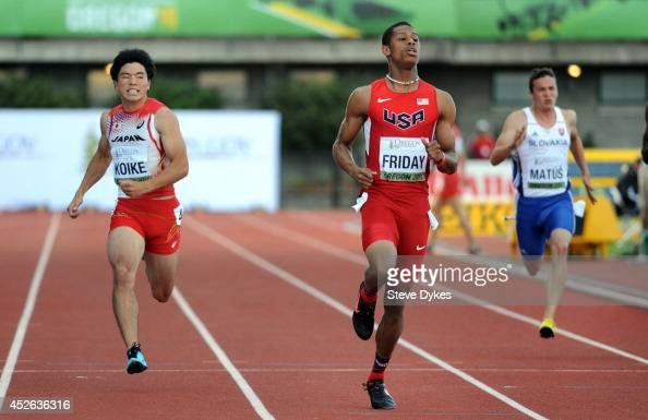 Trentavis Friday of USA crosses this finish line ahead of Yuki Koike of Japan and Jakub Matus of Slovakia in the semifinal of the men's 200m during...