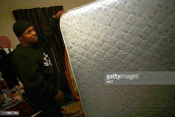 Trenton Allen goes through the nightly ritual of checking his mattress for bedbugs in the family's apartment in the Austin neighborhood of Chicago...