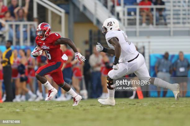 Trenton Bridges of the Bethune Cookman Wildcats pursues Kerrith Whyte Jr #6 of the Florida Atlantic Owls as he runs with the ball on September 16...