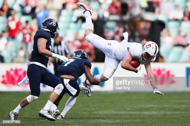 Trenton Irwin of Stanford is tackled during the College Football Sydney Cup match between Stanford University and Rice University at Allianz Stadium...