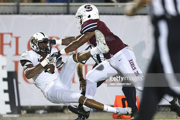Tre'Quan Smith of the UCF Knights catches a touchdown pass in front of Kendric Gathers of the South Carolina State Bulldogs during a NCAA football...