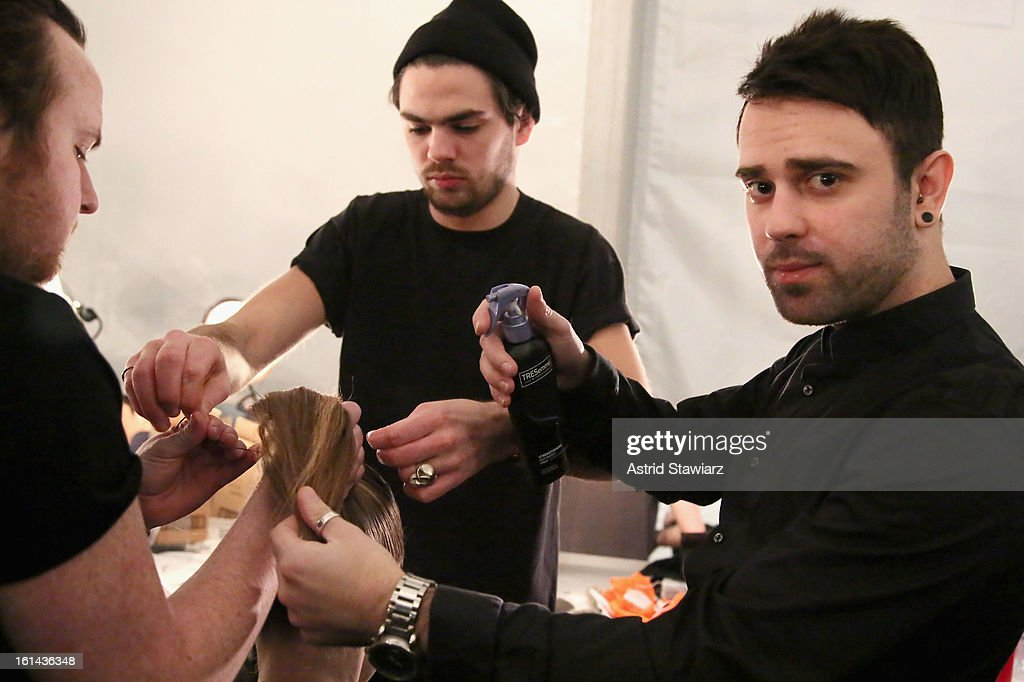 TRESemme hair stylist Matthew Curtis prepares a model backstage at the Vivienne Tam Fall 2013 fashion show with TRESemme during Mercedes-Benz Fashion Week at The Stage at Lincoln Center on February 10, 2013 in New York City.