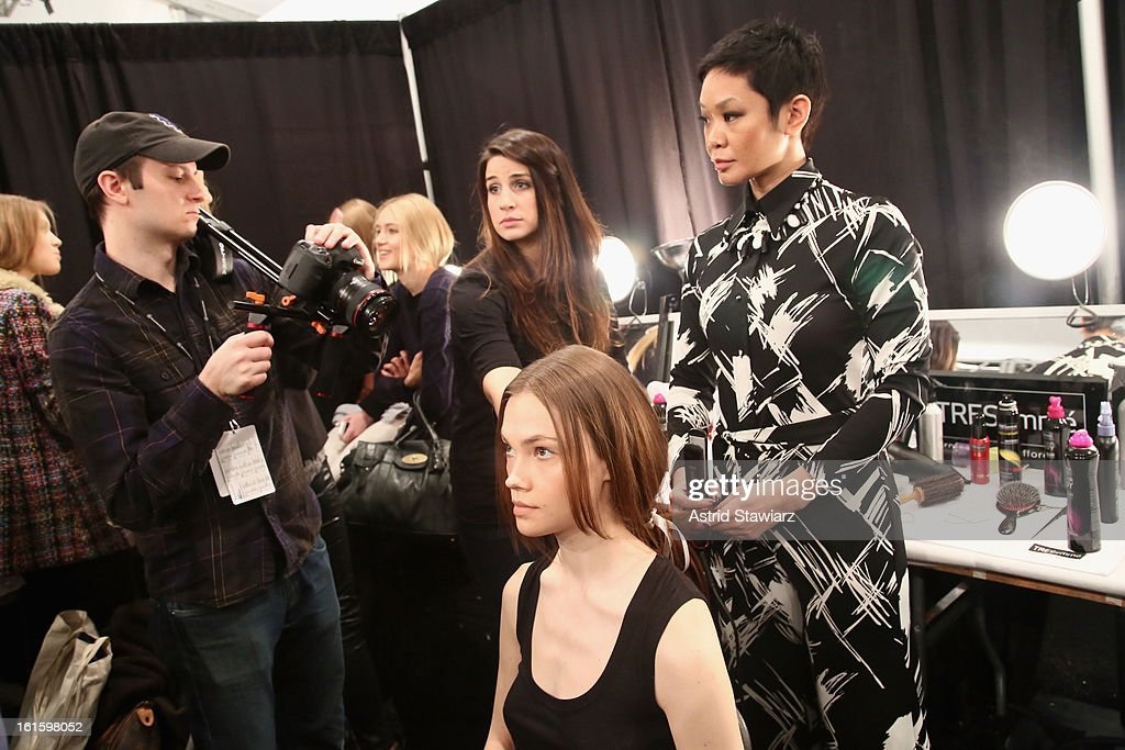 TRESemme lead hair stylist Jeanie Syfu prepares a model backstage at the TRESemme At Jenny Packham Fall 2013 fashion show during Mercedes-Benz Fashion Week at The Studio at Lincoln Center on February 12, 2013 in New York City.