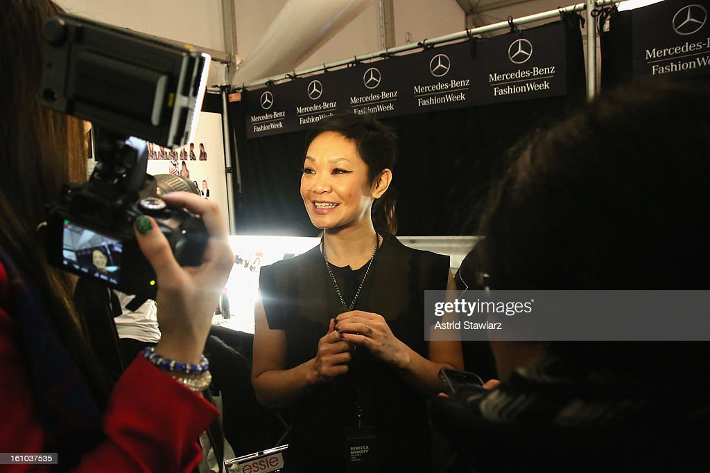 TRESemme lead hair stylist Jeanie Syfu prepares backstage at the TRESemme At Rebecca Minkoff Fall 2013 fashion show during Mercedes-Benz Fashion Week at The Theatre at Lincoln Center on February 8, 2013 in New York City.