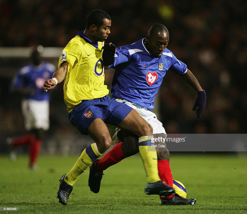 Tresor Lomana Lua Lua of Portsmouth holds off Ashley Cole of Arsenal during the Barclays Premiership match between Portsmouth and Arsenal at Fratton Park on December 19, 2004 in London, England.