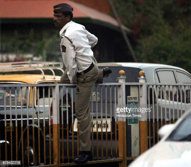 Trespassing Breaking Rules Traffic Police A traffic cop tries to cross the divider outside Churchgate station on Sunday