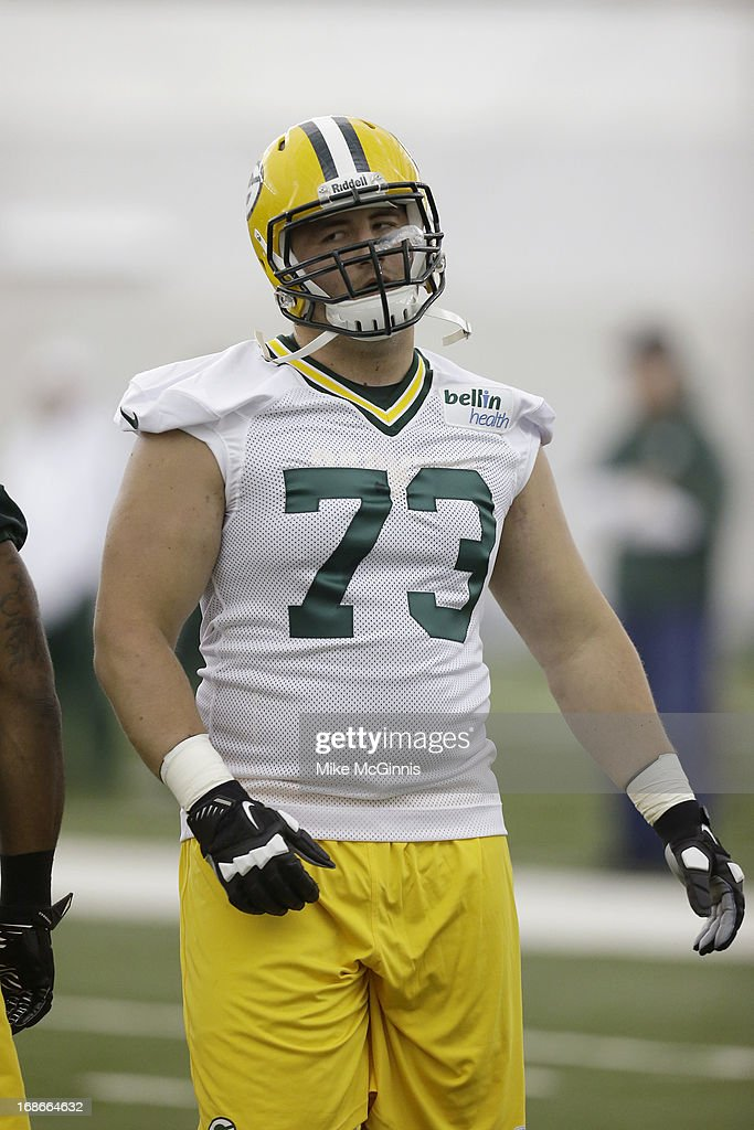 J.C. Tretter #73 of the Green Bay Packers runs through some warm ups before the start of rookie camp at the Don Hutson Center on May 10, 2013 in Green Bay, Wisconsin.