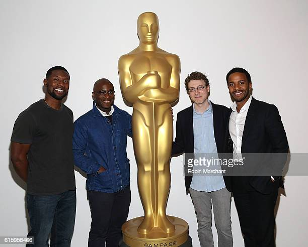 Trevante Rhodes Barry Jenkins Nicholas Britell and Andre Holland attend The Academy of Motion Picture Arts and Sciences hosts an Official Academy...