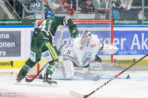 J Trevelyan of Augsburger Panther and Niklas Treutle of Nuernberg Ice Tigers battle for the ball during the DEL match between Augsburger Panther and...