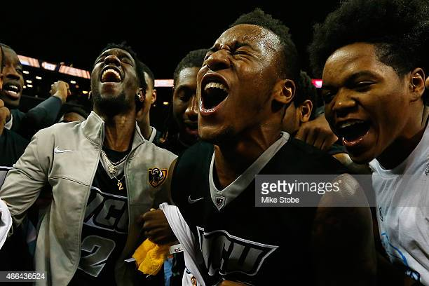 Treveon Graham Briante Weber Melvin Johnson and Justin Tillman of the Virginia Commonwealth Rams celebrate after defeating Dayton Flyers in the...