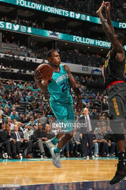 Treveon Graham of the Charlotte Hornets looks to pass against the Atlanta Hawks on October 20 2017 at Spectrum Center in Charlotte North Carolina...