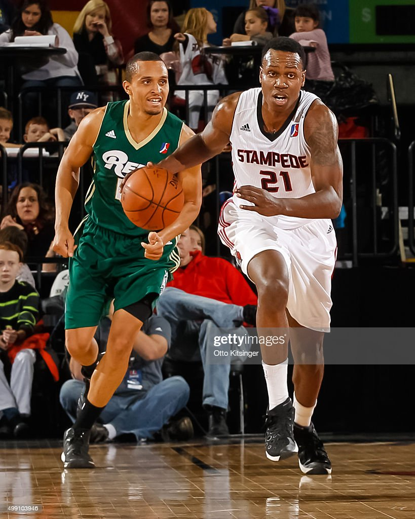 <a gi-track='captionPersonalityLinkClicked' href=/galleries/search?phrase=Treveon+Graham&family=editorial&specificpeople=8702328 ng-click='$event.stopPropagation()'>Treveon Graham</a> #21 of the Idaho Stampede moves the ball up the court past Reggie Hearn #17 of the Reno Bighorns at CenturyLink Arena on November 28, 2015 in Boise, Idaho.