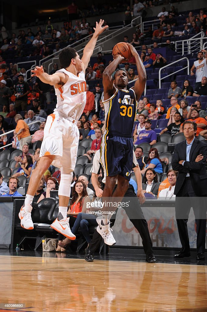 <a gi-track='captionPersonalityLinkClicked' href=/galleries/search?phrase=Treveon+Graham&family=editorial&specificpeople=8702328 ng-click='$event.stopPropagation()'>Treveon Graham</a> #30 of the Utah Jazz shoots over the block of <a gi-track='captionPersonalityLinkClicked' href=/galleries/search?phrase=Devin+Booker+-+Basketball+Guard+-+Born+1996&family=editorial&specificpeople=12728455 ng-click='$event.stopPropagation()'>Devin Booker</a> #1 of the Phoenix Suns on October 9, 2015, at Talking Stick Resort Arena in Phoenix, Arizona.