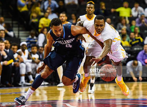 Treveon Graham of the Virginia Commonwealth Rams fights for the ball with Darrun Hilliard II of the Villanova Wildcats in the second half at the...