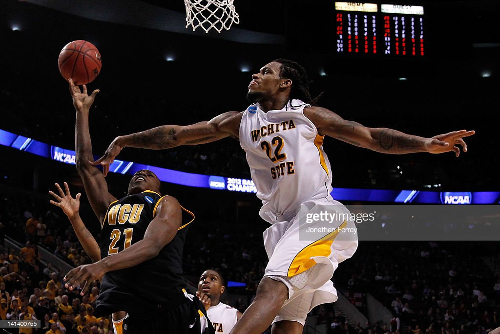 Treveon Graham #21 of the Virginia Commonwealth Rams goes up for a shot against Carl Hall #22 of the Wichita State Shockers in the second round of the 2012 NCAA men's basketball tournament at Rose Garden Arena on March 15, 2012 in Portland, Oregon.