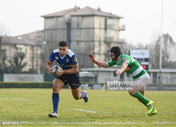 Treviso Italy 12 February 2017 Adam Byrne of Leinster goes over to score his side's fourth try despite the attention of Ian McKinley of Benetton...