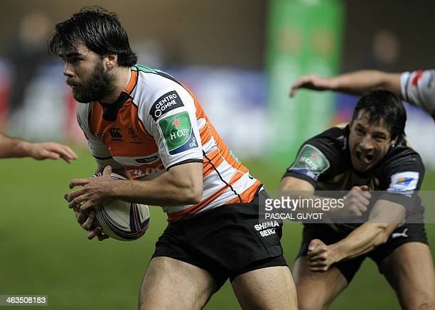 Treviso's Luc Mclean runs with the ball during the European Cup rugby union match Montpellier vs Treviso at the Yves du Manoir stadium on January 18...