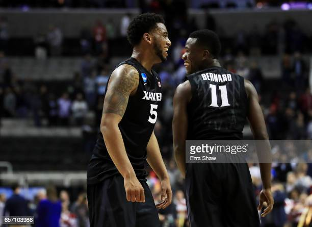 Trevon Bluiett and Malcolm Bernard of the Xavier Musketeers celebrate their 73 to 71 win over the Arizona Wildcats during the 2017 NCAA Men's...