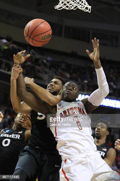 Trevon Bluiett of the Xavier Musketeers and Rawle Alkins of the Arizona Wildcats battle for the ball during the 2017 NCAA Men's Basketball Tournament...