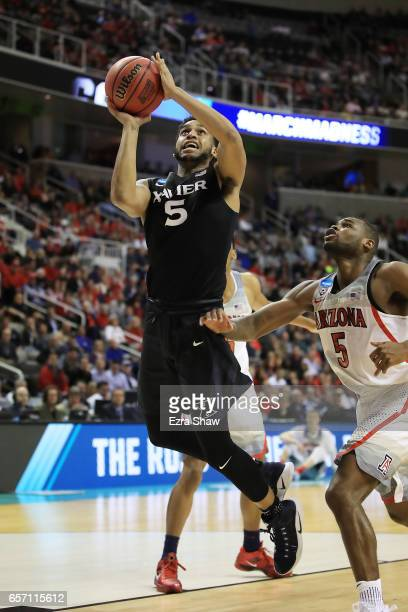 Trevon Bluiett of the Xavier Musketeers attempts a shot against the Arizona Wildcats during the 2017 NCAA Men's Basketball Tournament West Regional...