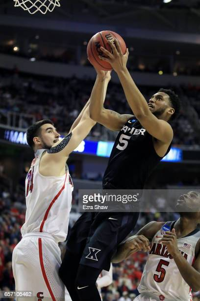 Trevon Bluiett of the Xavier Musketeers attempts a shot defended by Dusan Ristic of the Arizona Wildcats during the 2017 NCAA Men's Basketball...