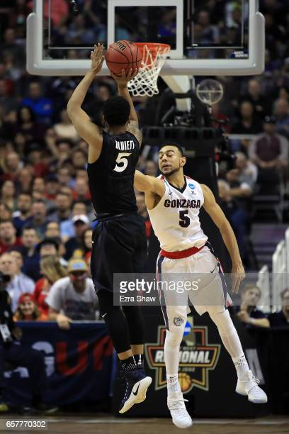 Trevon Bluiett of the Xavier Musketeers attempts a shot defended by Nigel WilliamsGoss of the Gonzaga Bulldogs during the 2017 NCAA Men's Basketball...
