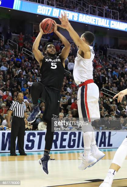 Trevon Bluiett of the Xavier Musketeers attempts a shot defended by Johnathan Williams of the Gonzaga Bulldogs during the 2017 NCAA Men's Basketball...