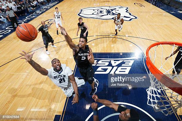 Trevon Bluiett of the Xavier Musketeers defends against Roosevelt Jones of the Butler Bulldogs in the first half of the game at Hinkle Fieldhouse on...
