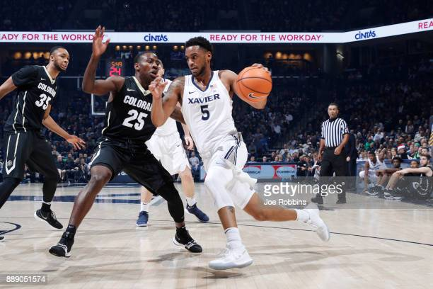 Trevon Bluiett of the Xavier Musketeers drives against McKinley Wright IV of the Colorado Buffaloes in the first half of a game at Cintas Center on...
