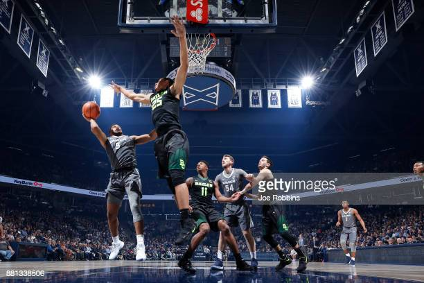 Trevon Bluiett of the Xavier Musketeers drives to the basket against Tristan Clark of the Baylor Bears in the first half of a game at Cintas Center...
