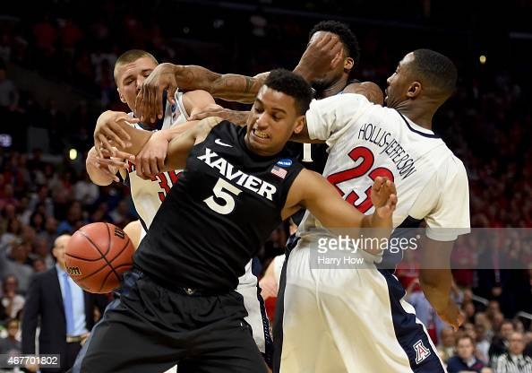 Trevon Bluiett of the Xavier Musketeers goes for a rebound against Kaleb Tarczewski and Rondae HollisJefferson of the Arizona Wildcats in the second...
