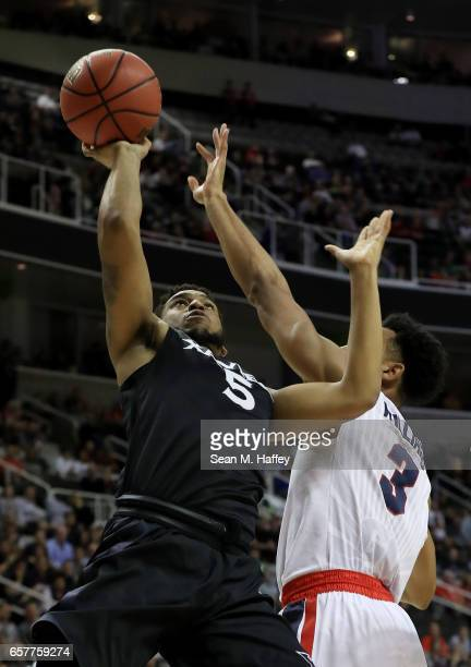 Trevon Bluiett of the Xavier Musketeers goes up against Johnathan Williams of the Gonzaga Bulldogs in the first half during the 2017 NCAA Men's...