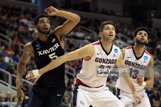Trevon Bluiett of the Xavier Musketeers is boxed out by Killian Tillie and Josh Perkins of the Gonzaga Bulldogs during the 2017 NCAA Men's Basketball...