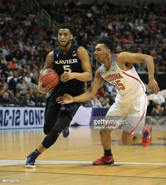 Trevon Bluiett of the Xavier Musketeers is defended by Allonzo Trier of the Arizona Wildcats during the 2017 NCAA Men's Basketball Tournament West...