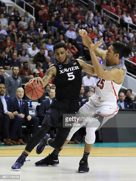 Trevon Bluiett of the Xavier Musketeers is defended by Keanu Pinder of the Arizona Wildcats during the 2017 NCAA Men's Basketball Tournament West...