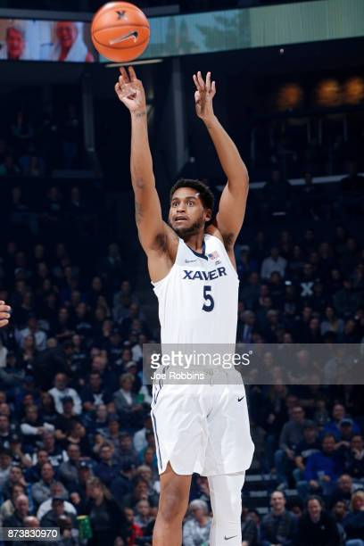 Trevon Bluiett of the Xavier Musketeers shoots the ball against the Rider Broncs in the first half of a game at Cintas Center on November 13 2017 in...
