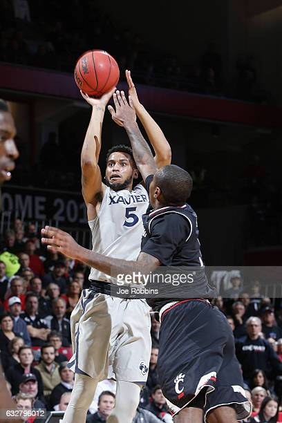 Trevon Bluiett of the Xavier Musketeers shoots the ball in the first half of the game against the Cincinnati Bearcats at Fifth Third Arena on January...