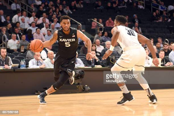 Trevon Bluiett of the Xavier Musketeers tries to dribbles around Kelan Martin of the Butler Bulldogs during the Big East Basketball Tournament...
