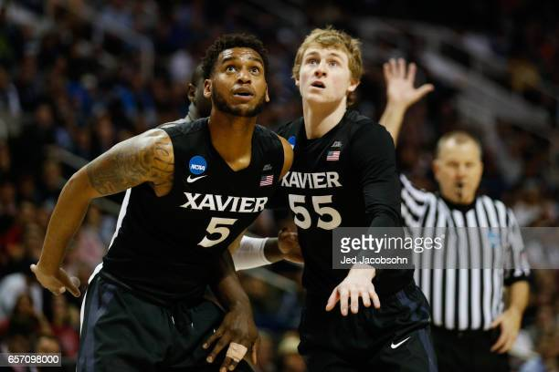 Trevon Bluiett of the Xavier University Musketeers and JP Macura of the Xavier University Musketeers have their eye on the ball against the...