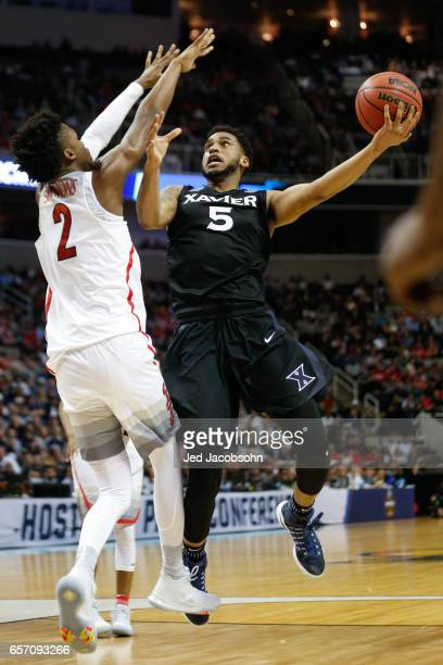Trevon Bluiett of the Xavier University Musketeers drives against the University of Arizona Wildcats during the 2017 NCAA Men's Basketball Tournament...